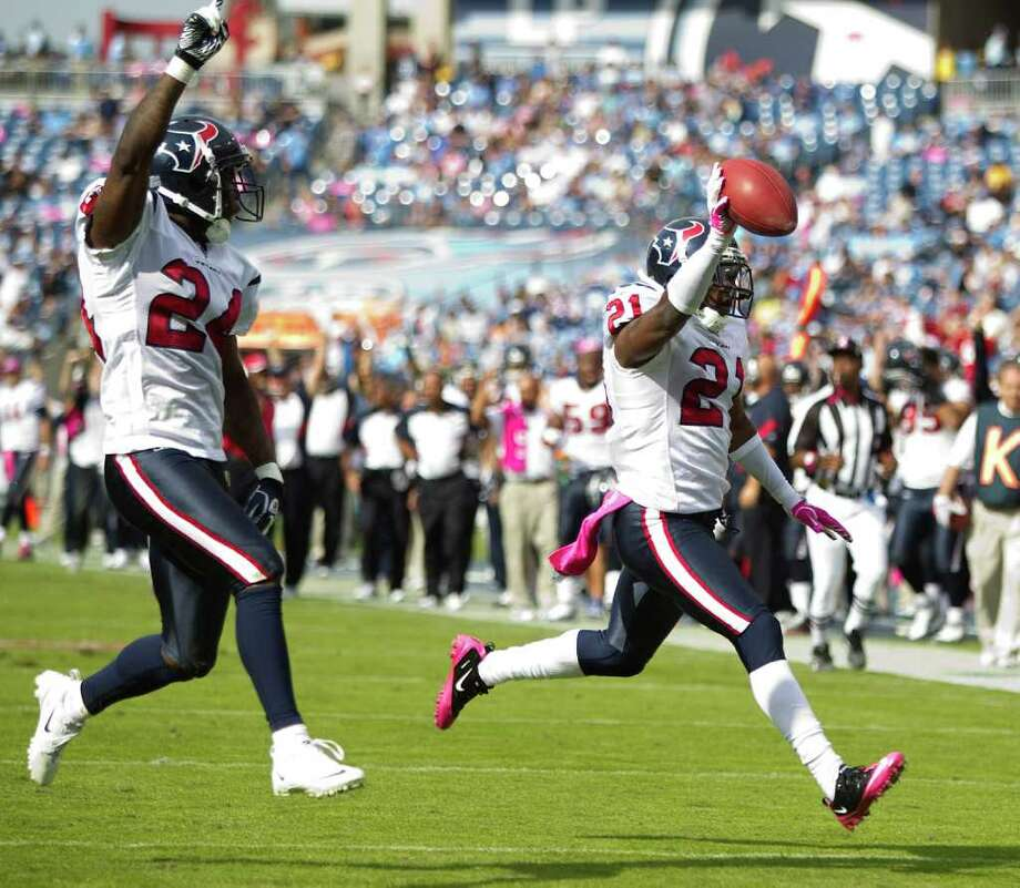 Houston Texans cornerback Johnathan Joseph (24), left, runs with teammate Brice McCain (21) as McCain returns an interception of a pass by Tennessee Titans quarterback Matt Hasselbeck for a touchdown during the fourth quarter of an NFL football game at LP Field Sunday, Oct. 23, 2011, in Nashville. The Texans beat the Titans 41-7. Photo: Brett Coomer, Houston Chronicle / © 2011  Houston Chronicle