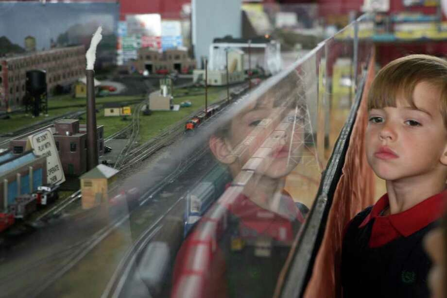 Myles Shanley, 5, of Weston, watches trains  at the Valley N'Trak's layout at the 25th Annual Model railroad Show on Sunday, October, 23, 2011. Housatonic Model Railway Club and Fairfield Museum and History Center presented the show at Fairfield Warde High School. Photo: B.K. Angeletti / Connecticut Post