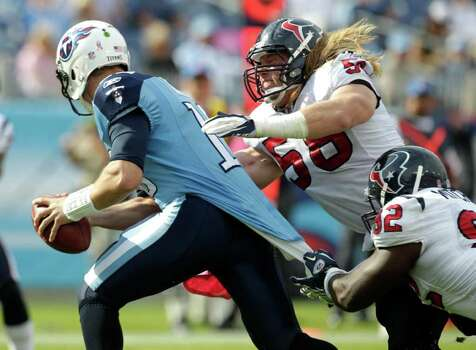 Houston Texans outside linebacker Brooks Reed (58) and defensive tackle Earl Mitchell (92) sack Tennessee Titans quarterback Jake Locker (10) during the fourth quarter of an NFL football game at LP Field Sunday, Oct. 23, 2011, in Nashville. The Texans beat the Titans 41-7. Photo: Brett Coomer, Houston Chronicle / © 2011  Houston Chronicle