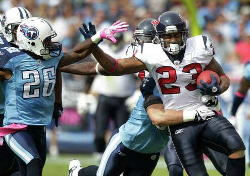 Houston Texans running back Arian Foster (23) is caught by Tennessee Titans strong safety Jordan Babineaux (26) during the first quarter of an NFL football game at LP Field Sunday, Oct. 23, 2011, in Nashville. The Texans beat the Titans 41-7. Photo: Brett Coomer, Houston Chronicle / © 2011  Houston Chronicle