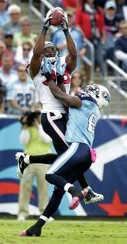 Houston Texans free safety Danieal Manning (38) leaps over Tennessee Titans wide receiver Lavelle Hawkins (87) to pull down an interception during the second quarter of an NFL football game at LP Field Sunday, Oct. 23, 2011, in Nashville. The Texans beat the Titans 41-7. Manning left the game after that play with a leg injury. Photo: Brett Coomer, Houston Chronicle / © 2011  Houston Chronicle