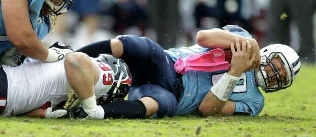 Tennessee Titans quarterback Matt Hasselbeck (8) hits the turf after he is sacked by Houston Texans defensive end J.J. Watt (99) during the third quarter of an NFL football game at LP Field Sunday, Oct. 23, 2011, in Nashville. The Texans beat the Titans 41-7. Photo: Brett Coomer, Houston Chronicle / © 2011  Houston Chronicle