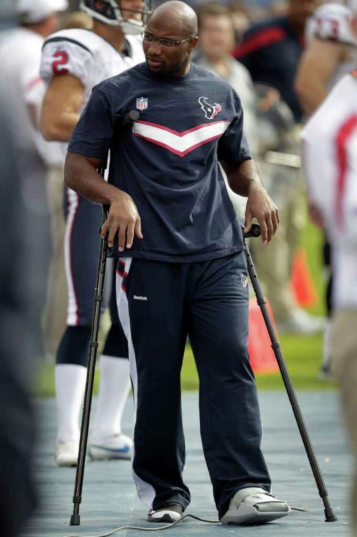 Houston Texans free safety Danieal Manning stands on the sidelines on crutches after suffering an injury to his leg during an NFL football game against the Tennessee Titans at LP Field Sunday, Oct. 23, 2011, in Nashville. The Texans beat the Titans 41-7.