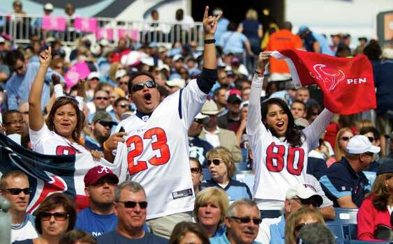 Houston Texans fans cheer after Texans running back Arian Foster scored a touchdown during the third quarter of an NFL football game against the Tennessee Titans at LP Field Sunday, Oct. 23, 2011, in Nashville. The Texans beat the Titans 41-7. Photo: Brett Coomer, Houston Chronicle / © 2011  Houston Chronicle