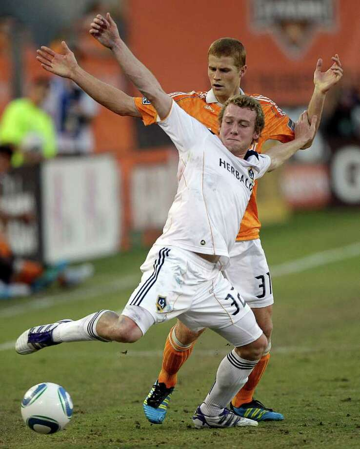 HOUSTON - OCTOBER 23:  Jack McBean #32 of the Los Angeles Galaxy battles with Andre Hainult #31 of the Houston Dynamo for the ball at Robertson Stadium on October 23, 2011 in Houston, Texas. Photo: Bob Levey, Getty / 2011 Getty Images