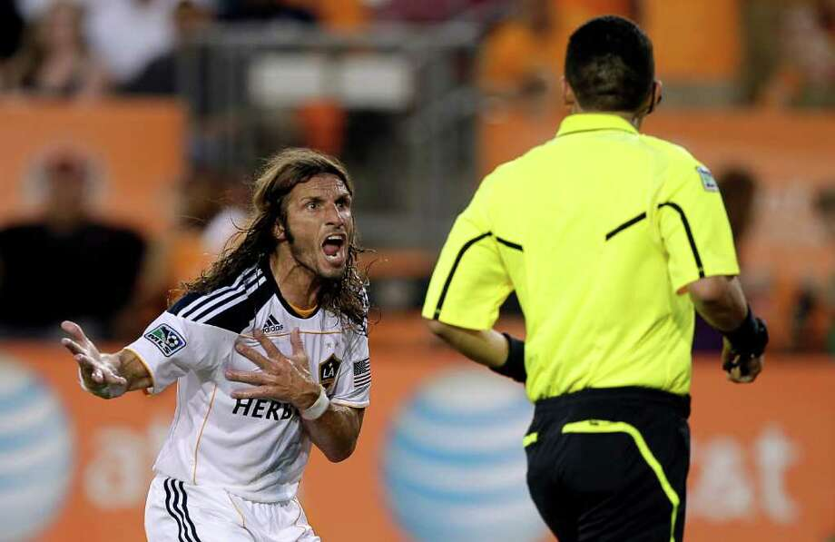 HOUSTON - OCTOBER 23:  Frankie Hejduk #6 of the Los Angeles Galaxy argues with referee Jorge Gonzalez after he thought he was penalized for a hand ball in the box against the Houston Dynamo at Robertson Stadium on October 23, 2011 in Houston, Texas. Photo: Bob Levey, Getty / 2011 Getty Images