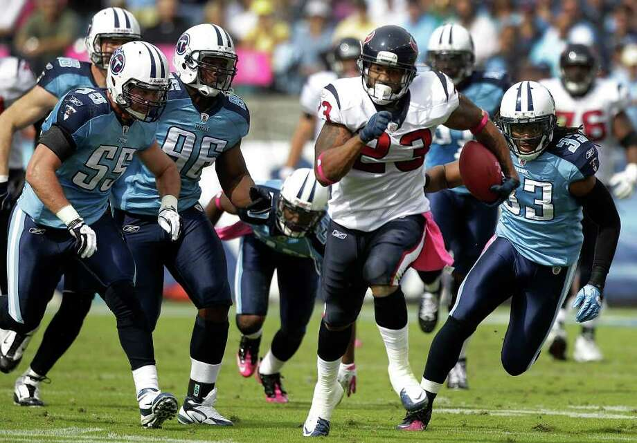 Houston Texans running back Arian Foster (23) breaks away from Tennessee Titans middle linebacker Barrett Ruud (55), defensive tackle Malcolm Sheppard (96) and Titans free safety Michael Griffin (33) for a 16-yard gain during the first quarter of an NFL football game at LP Field Sunday, Oct. 23, 2011, in Nashville. Photo: Brett Coomer, Houston Chronicle / © 2011  Houston Chronicle