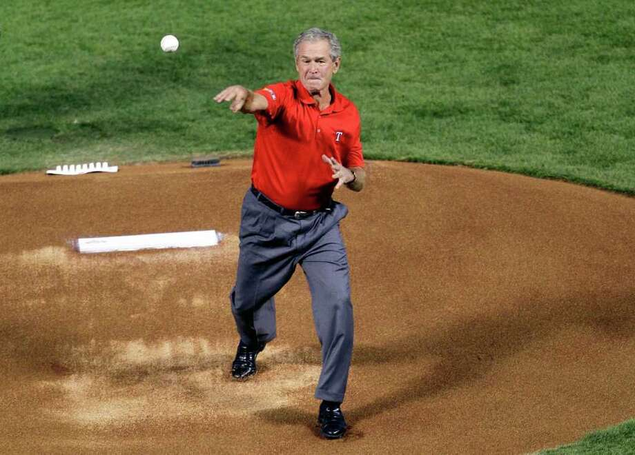 Former president George W. Bush throws out the ceremonial first pitch prior to Game Four of the MLB World Series between the St. Louis Cardinals and the Texas Rangers at Rangers Ballpark in Arlington on October 23, 2011 in Arlington, Texas. Photo: Rob Carr, Getty / 2011 Getty Images