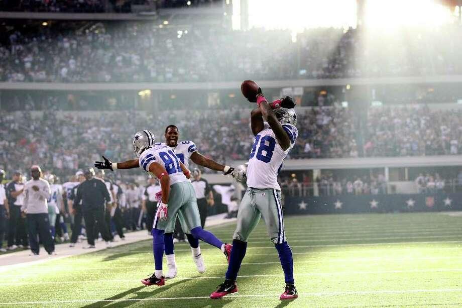 78b39fe9082 Dallas Cowboys wide receiver Dez Bryant, (88), celebrates a fourth quarter  touchdown
