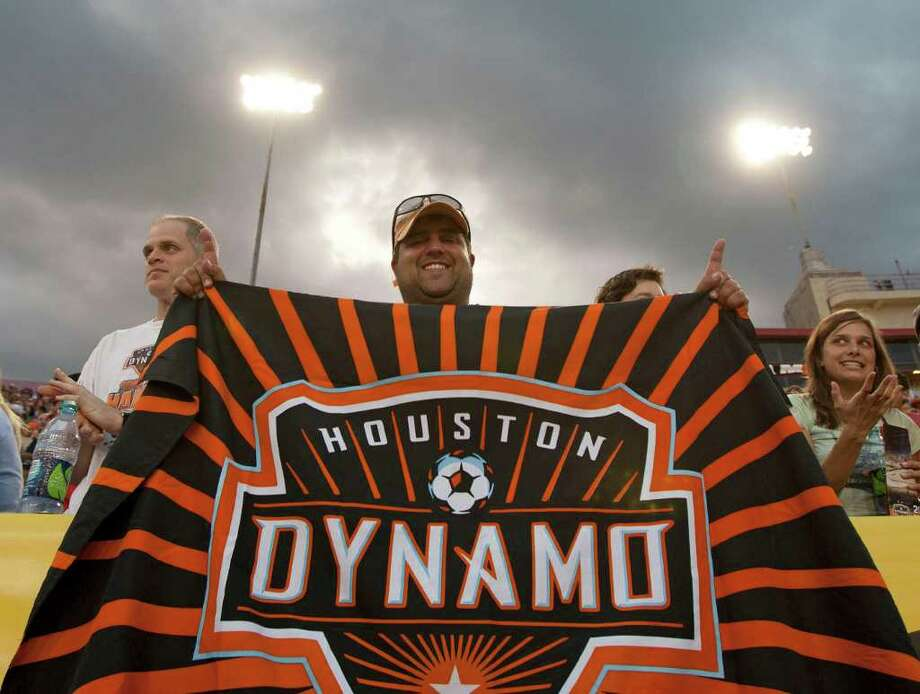 Billy Papalexandris holds up a Houston Dynamo banner after the Dynamo scored a goal against the LA Galaxy during the first period of MLS game action at Robertson Stadium Sunday, Oct. 23, 2011, in Houston. Photo: James Nielsen, Chronicle / © 2011 Houston Chronicle