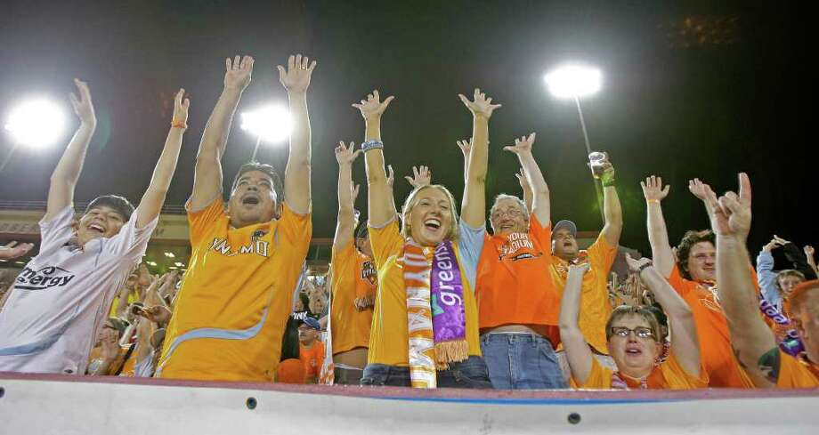Fans do the wave as the Houston Dynamo play the LA Galaxy during the second period at Robertson Stadium Sunday, Oct. 23, 2011, in Houston. Photo: James Nielsen, Chronicle / © 2011 Houston Chronicle