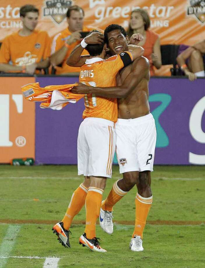 The Houston Dynamo's Carlo Costly left, celebrates teammateBrad Davis after Costly scored a goal against the LA Galaxy during the second period at Robertson Stadium Sunday, Oct. 23, 2011, in Houston. Photo: James Nielsen, Chronicle / © 2011 Houston Chronicle
