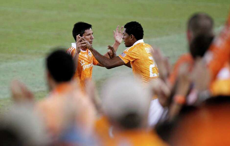The Houston Dynamo's Brain Ching left, is replaced by Carlo Costly right, as the Dynamo face the LA