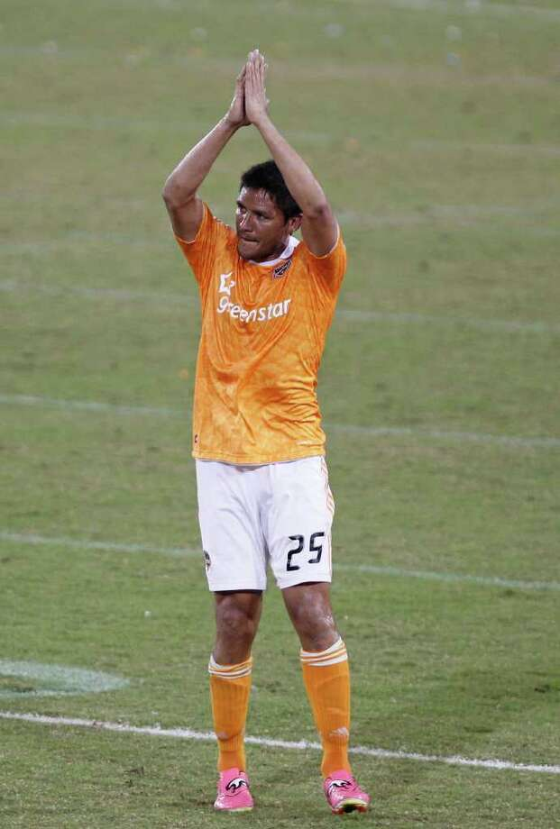 The Houston Dynamo's Brian Ching  claps his hands as he leaves the game in the second period of MLS game action against the LA Galaxy at Robertson Stadium Sunday, Oct. 23, 2011, in Houston. Photo: James Nielsen, Chronicle / © 2011 Houston Chronicle