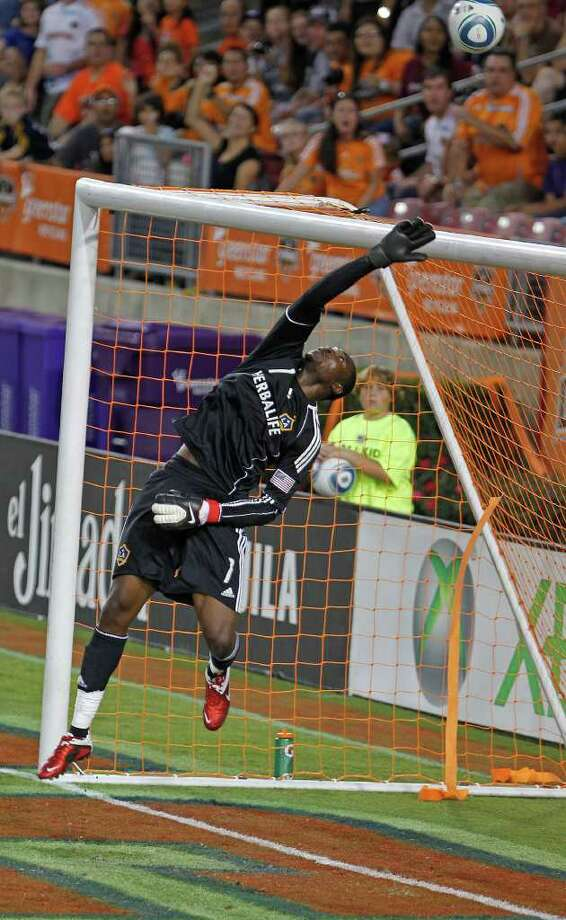 Donovan Ricketts of the LA Galaxy jumps in the air as a shot by the Houston Dynamo passes overhead during the first period of MLS game action at Robertson Stadium Sunday, Oct. 23, 2011, in Houston. Photo: James Nielsen, Chronicle / © 2011 Houston Chronicle