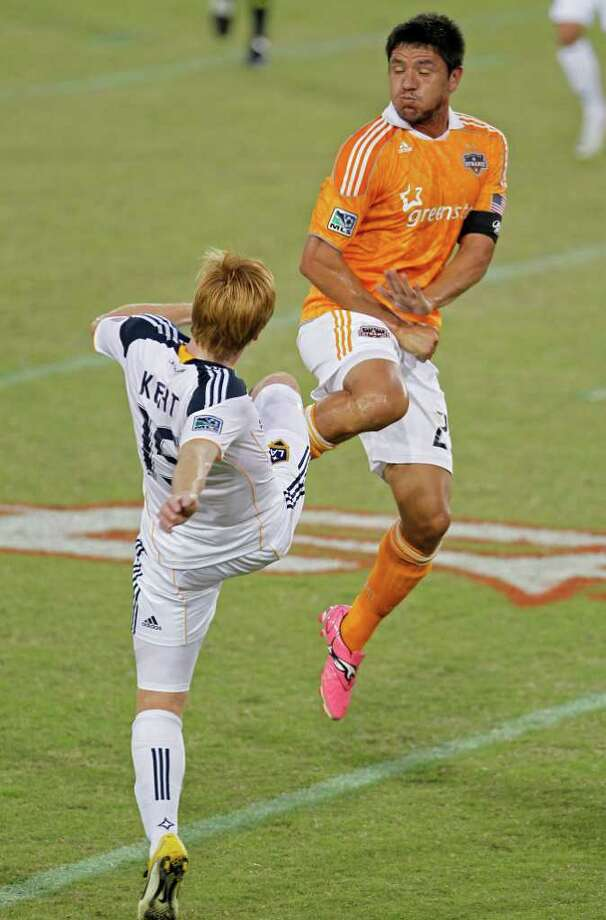 The Houston Dynamo's Brian Ching left, collides with Dan Kent of the LA Galaxy during the first period in MLS game action at Robertson Stadium Sunday, Oct. 23, 2011, in Houston. Photo: James Nielsen, Chronicle / © 2011 Houston Chronicle