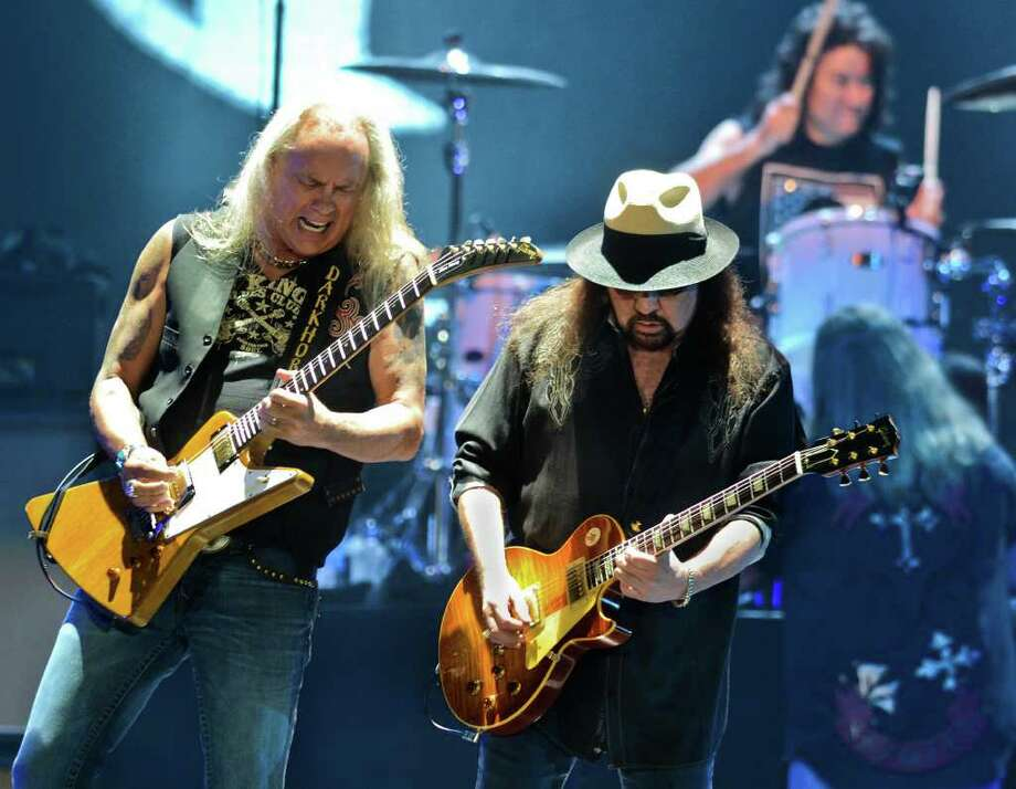 Lynyrd Skynyrd Guitarists Rickey Medlocke, Gary Rossington and drummer  Michael Cartellone perform for the crowd at the Laredo Energy Arena, Sunday evening. Photo: Danny Zaragoza / LAREDO MORNING TIMES