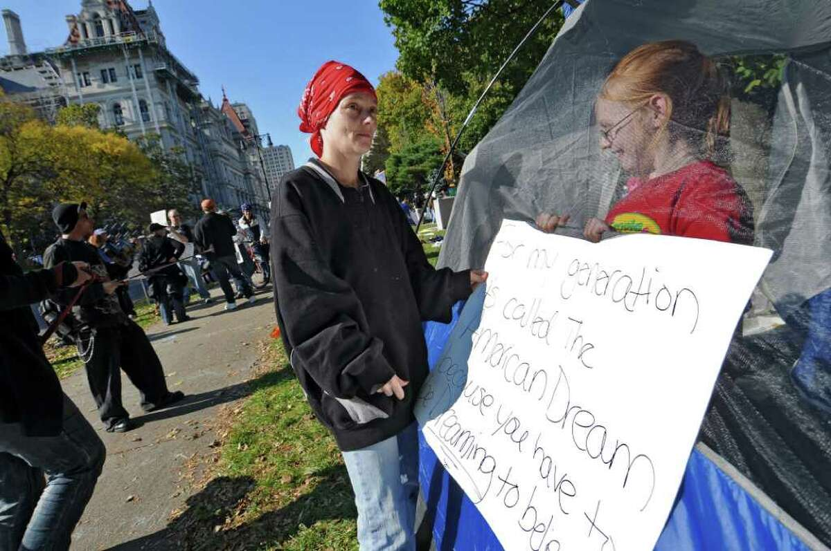 Ann LaRose of Albany is helped by her daughter Megan, 12, while setting up a donated tent during the Occupy Albany protest in Academy Park across from the Capitol on Sunday Oct. 23, 2011 in Albany, NY. LaRose was there to support the people protesting there, as well as to protest greed.