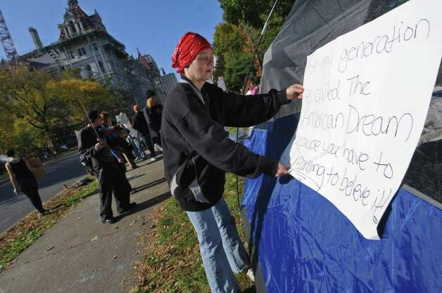 "Ann LaRose of Albany sets up a donated tent during the Occupy Albany protest in Academy Park across from the Capitol on Sunday Oct. 23, 2011 in Albany, NY.  LaRose was there to support the people protesting there, as well as to protest greed. ""We're only asking for equal advantages, "" she said, adding that it is hard to afford housing and food.  (Philip Kamrass / Times Union ) Photo: Philip Kamrass"