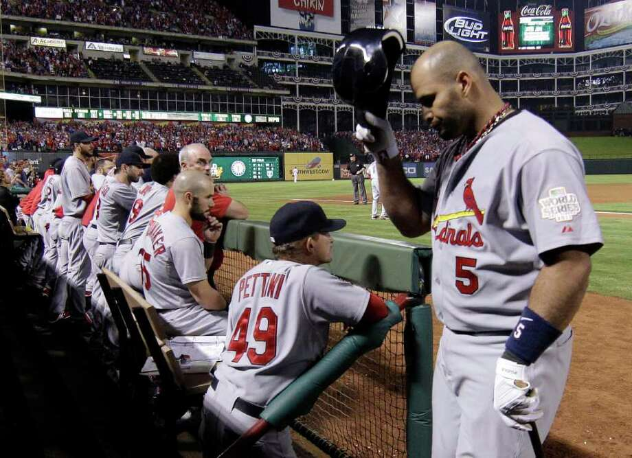St. Louis Cardinals' Albert Pujols reacts as he walks back to the dugout after flying out during the ninth inning of Game 4 of baseball's World Series against the Texas Rangers Sunday, Oct. 23, 2011, in Arlington, Texas. The Rangers won 4-0 to tie the series at 2-2. (AP Photo/Matt Slocum) Photo: Matt Slocum, Associated Press / AP