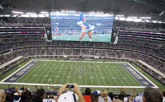 Cheerleaders are shown on the giant screen at the NFL football game between the St. Louis Rams and Dallas Cowboys at Cowboys Stadium in Arlington, Texas, Sunday, Oct. 23, 2011.. (AP Photo/Sharon Ellman) Photo: Sharon Ellman, Associated Press / FR170032AP