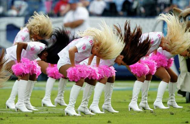 Tennessee Titans cheerleaders perform in the second quarter of an NFL football game against the Houston Texans on Sunday, Oct. 23, 2011, in Nashville, Tenn. (AP Photo/Wade Payne) Photo: Wade Payne, Associated Press / FR23601 AP
