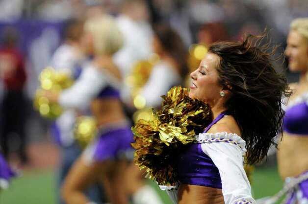 Minnesota Vikings cheerleaders perform during the first half of an NFL football game against the Green Bay Packers Sunday, Oct. 23, 2011, in Minneapolis. (AP Photo/Jim Mone) Photo: Jim Mone, Associated Press / AP
