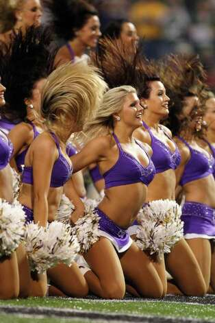 Minnesota Vikings cheerleaders perform during the second half of an NFL football game against the Green Bay Packers Sunday, Oct. 23, 2011, in Minneapolis. (AP Photo/Andy King) Photo: Andy King, Associated Press / FR51399 AP