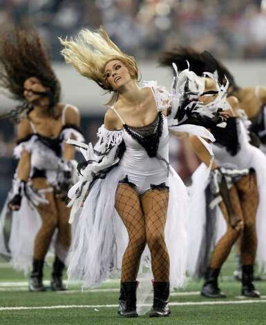 Dallas Cowboys cheerleader perform during the half-time show during the NFL football game against the St. Louis Rams at Cowboys Stadium in Arlington, Texas, Sunday, Oct. 23, 2011. (AP Photo/Brandon Wade) Photo: Brandon Wade, Associated Press / FR168019 AP