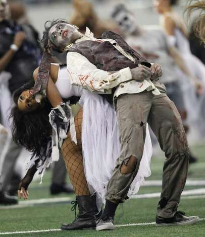 Dallas Cowboys cheerleader perform a Thriller themed show during the half-time show during the NFL football game against the St. Louis Rams at Cowboys Stadium in Arlington, Texas, Sunday, Oct. 23, 2011.(AP Photo/Brandon Wade) Photo: Brandon Wade, Associated Press / FR168019 AP