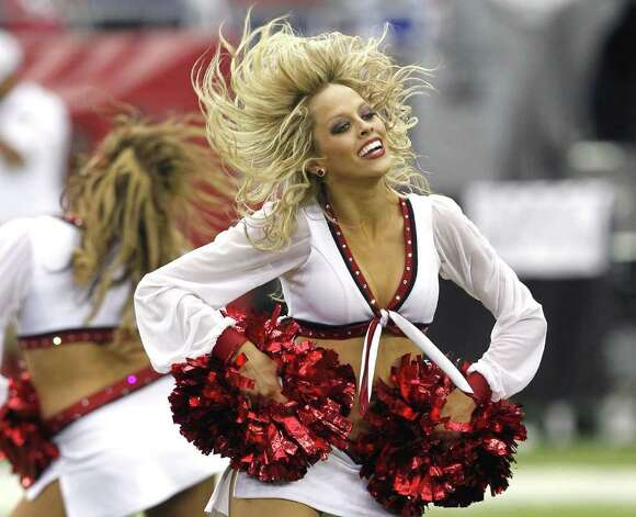 An Arizona Cardinals cheerleader performs during halftime in an NFL football game between the Pittsburgh Steelers and the Cardinals, Sunday, Oct. 23, 2011, in Glendale, Ariz. (AP Photo/Ross D. Franklin) Photo: Ross D. Franklin, Associated Press / AP