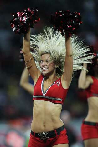 LONDON, ENGLAND - OCTOBER 23:  Tampa Bay Buccaneers cheerleaders perform during the NFL International Series match between Chicago Bears and Tampa Bay Buccaneers at Wembley Stadium on October 23, 2011 in London, England. This is the fifth occasion where a regular season NFL match has been played in London.  (Photo by Streeter Lecka/Getty Images) *** BESTPIX *** Photo: Streeter Lecka, Getty / 2011 Getty Images
