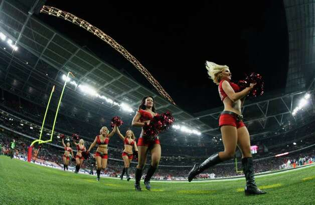 LONDON, ENGLAND - OCTOBER 23:  Tampa Bay Buccaneers cheerleaders perform during the NFL International Series match between Chicago Bears and Tampa Bay Buccaneers at Wembley Stadium on October 23, 2011 in London, England. This is the fifth occasion where a regular season NFL match has been played in London. Photo: Streeter Lecka, Getty / 2011 Getty Images