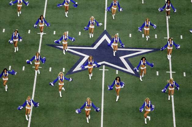 Dallas Cowboys cheerleader perform before the NFL football game at Cowboys Stadium in Arlington, Texas, Sunday, Oct. 23, 2011. (AP Photo/Sharon Ellman) Photo: Sharon Ellman, Associated Press / FR170032AP