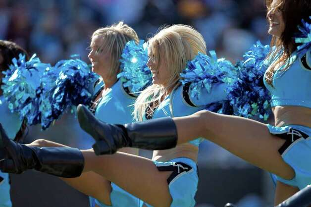 Carolina Panthers cheerleaders perform during the third quarter of an NFL football game against the Washington Redskins in Charlotte, N.C., Sunday, Oct. 23, 2011. (AP Photo/Bob Leverone) Photo: Bob Leverone, Associated Press / FR170480 AP
