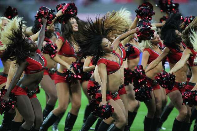 LONDON, ENGLAND - OCTOBER 23:  Tampa Bay Buccaneers cheerleaders perform prior to the NFL International Series match between Chicago Bears and Tampa Bay Buccaneers at Wembley Stadium on October 23, 2011 in London, England. This is the fifth occasion where a regular season NFL match has been played in London. Photo: Streeter Lecka, Getty / 2011 Getty Images