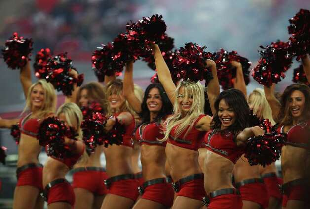 LONDON, ENGLAND - OCTOBER 23:  Tampa Bay Buccaneers cheerleaders perform prior to the NFL International Series match between Chicago Bears and Tampa Bay Buccaneers at Wembley Stadium on October 23, 2011 in London, England. This is the fifth occasion where a regular season NFL match has been played in London. Photo: Warren Little, Getty / 2011 Getty Images