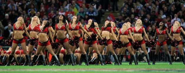 The Tampa Bay Buccaneers cheerleaders perform during the first half of an NFL football game Sunday, Oct. 23, 2011, at Wembley Stadium in London. (AP Photo/Matt Dunham) Photo: Matt Dunham, Associated Press / AP