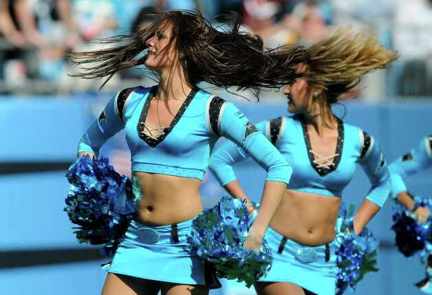 Carolina Panthers cheerleaders perform during the first quarter of an NFL football game against the Washington Redskins  in Charlotte, N.C., Sunday, Oct. 23, 2011. Photo: AP