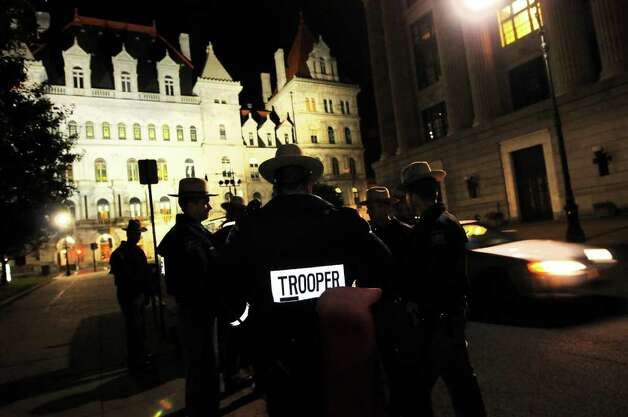 State troopers stand by on Hawk Street, just outside Academy Park, during Occupy Albany on Friday, Oct. 21, 2011, in Albany, N.Y. (Cindy Schultz / Times Union) Photo: Cindy Schultz, Albany Times Union / 00015065A