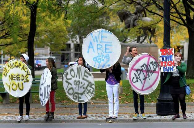 Protesters hold signs and encourage drivers to honk during the Occupy Albany on Friday, Oct. 21, 2011, on Washington Avenue in Albany, N.Y. (Cindy Schultz / Times Union) Photo: Cindy Schultz, Albany Times Union / 00015065A