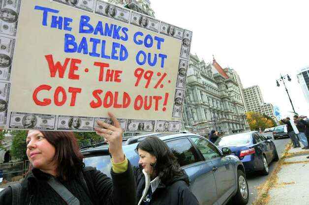 Beth Schneck, left, hold a sign during Occupy Albany on Friday, Oct. 21, 2011, on Washington Avenue in Albany, N.Y. (Cindy Schultz / Times Union) Photo: Cindy Schultz, Albany Times Union / 00015065A