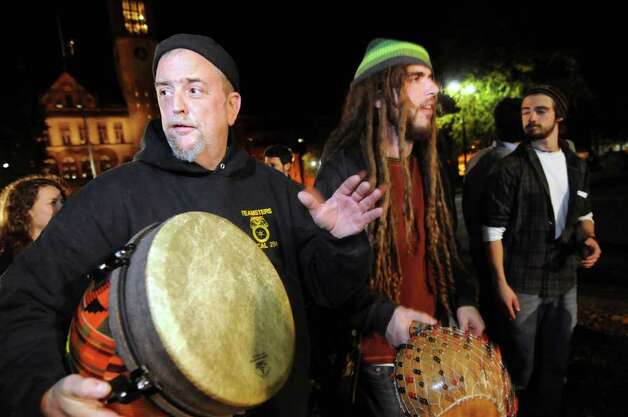 Andy Bottum, left, and David DiPasquale, both of Albany, play percussion instruments during Occupy Albany on Friday, Oct. 21, 2011, at Academy Park in Albany, N.Y. (Cindy Schultz / Times Union) Photo: Cindy Schultz, Albany Times Union / 00015065A