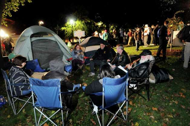Participants pitch tents and camp out during Occupy Albany on Friday, Oct. 21, 2011, at Academy Park in Albany, N.Y. (Cindy Schultz / Times Union) Photo: Cindy Schultz, Albany Times Union / 00015065A