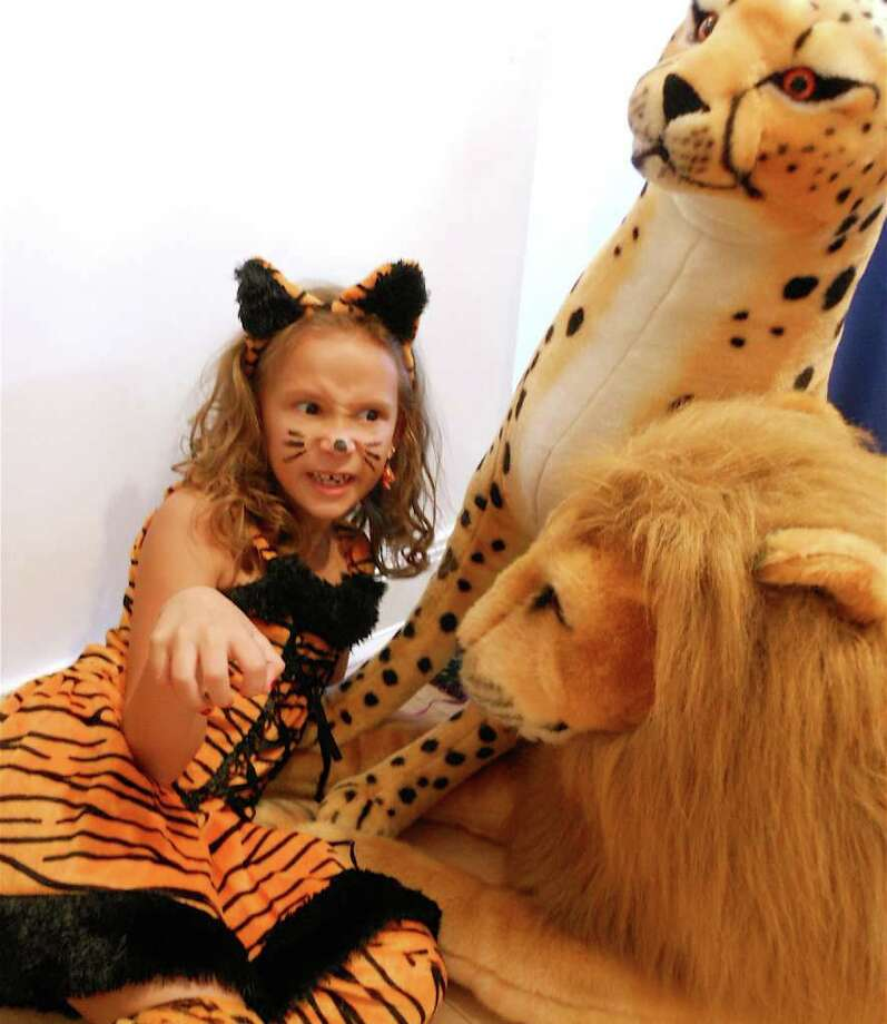 Harper Giola, 7, a tigress with a couple of jungle pals, had a roaring good time Sunday at the WACky Halloween party at the Westport Arts Center. Photo: Mike Lauterborn / Westport News contributed