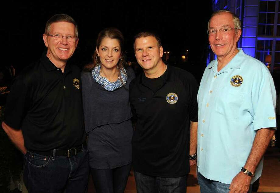 From left: Executive Assistant Police Chief Tim Oettmeier, Paige and Tilman Fertitta and John Nau Photo: Dave Rossman / © 2011 Dave Rossman