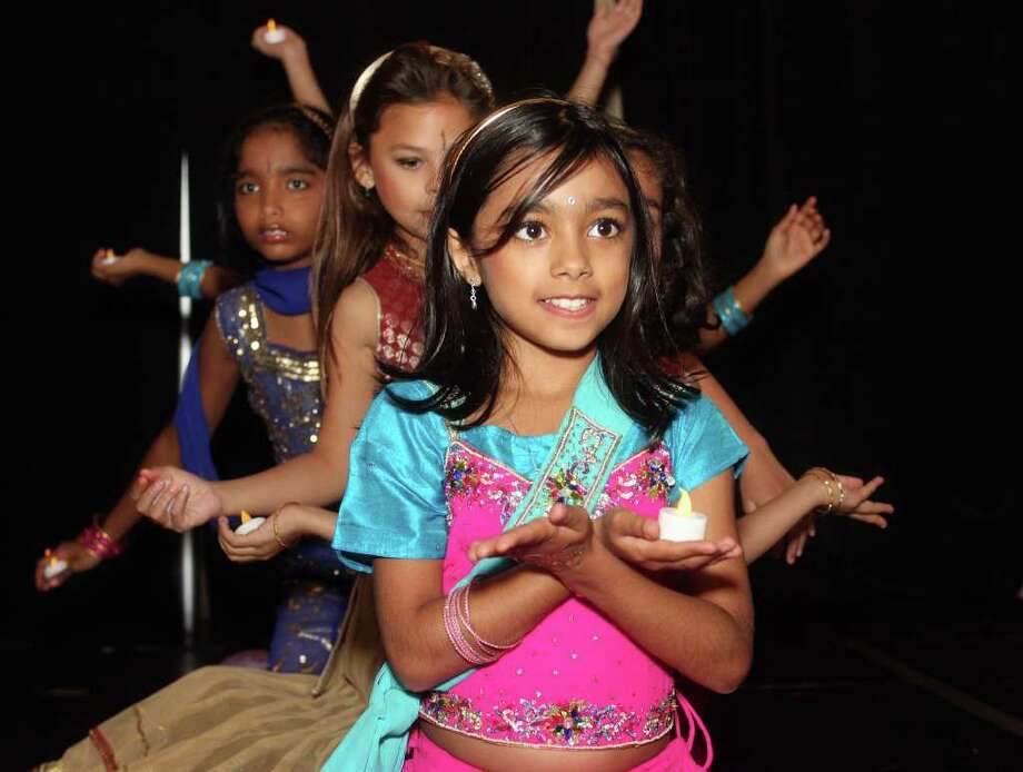 Veda Malhora, 8, of Darien performs with fellow dancers at Diwali's fourth annual celebration of lights festival at UCONN in Stamford, Conn. on Saturday October 22, 2011. Hundreds of people attended the gala event which featured food, song, dance and raffles. Photo: J. Gregory Raymond / Stamford Advocate Freelance