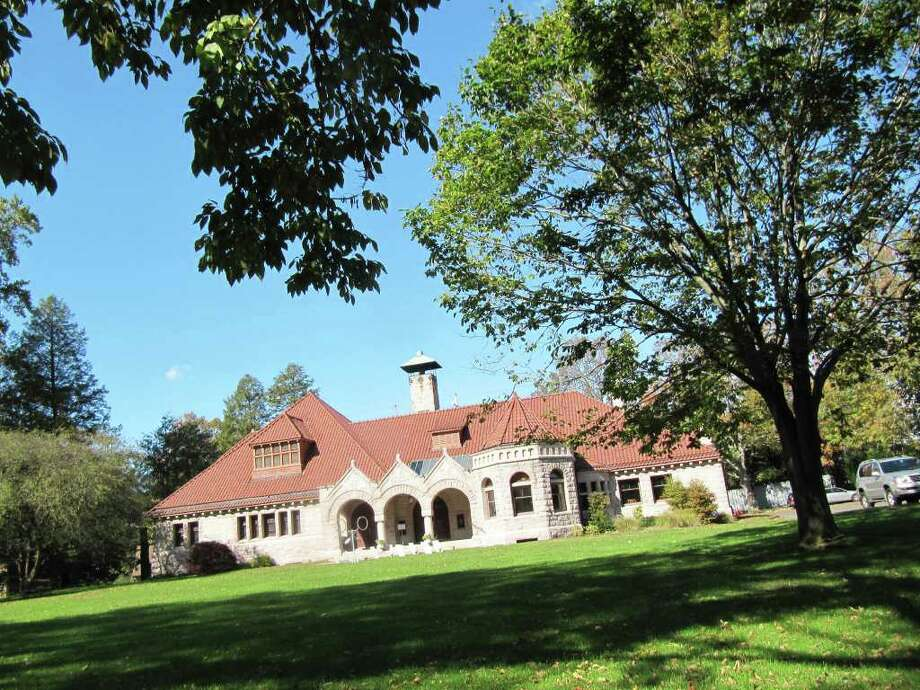 Pictured is the Pequot Library, 720 Pequot Ave. Tree wardens in both Fairfield and Westport said that fall foliage has been duller than years past, in part because of the salt spray from Hurricane Irene. Photo: Kirk Lang / Fairfield Citizen