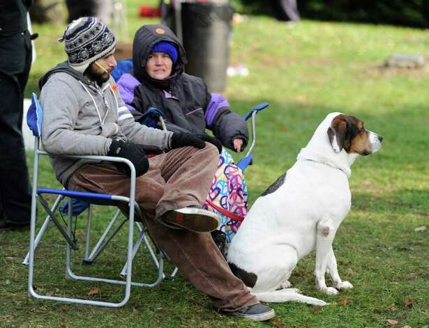 Patrick Buonacore and Elizabeth Grot speak about economics as their dog eyes a photographer at the Occupy Albany encampment in Academy Park in Albany on Tuesday, Oct. 24, 2011. (SKIP DICKSTEIN / TIMES UNION) Photo: Skip Dickstein / NWest PRS 2011