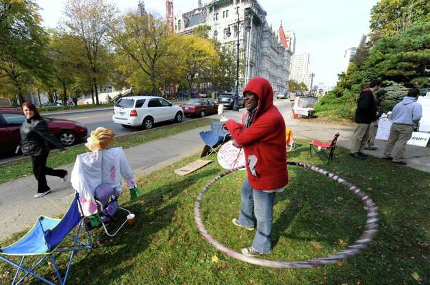 Karena Williams of Freeport on Long Island uses a Hula Hoop to stay in shape during her time at the Occupy Albany encampment in Academy Park in Albany on Monday, Oct. 24, 2011. (SKIP DICKSTEIN / TIMES UNION) Photo: Skip Dickstein / NWest PRS 2011